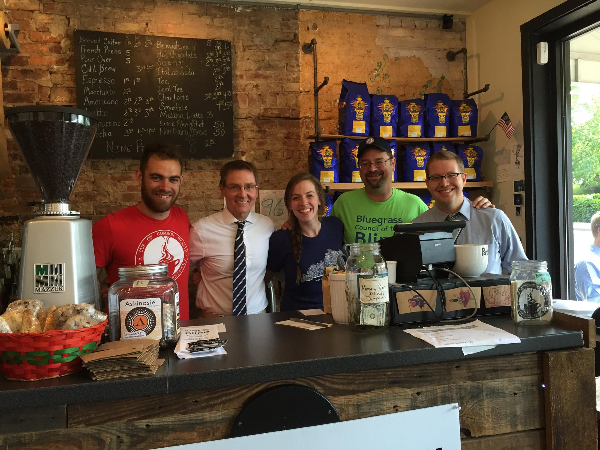 group standing behind counter at cup of common wealth